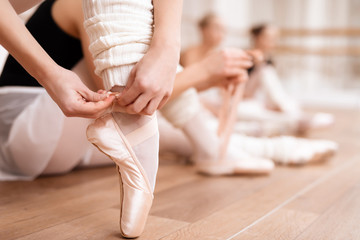 Ballerinas correct pointe shoes.