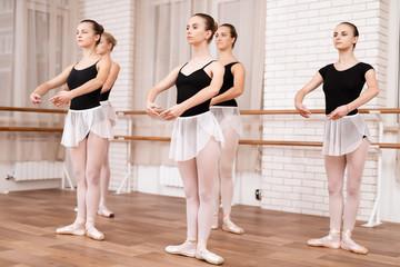 Girls ballet dancers rehearse in ballet class.