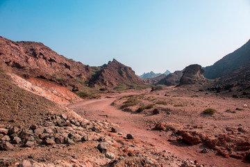 Road through the red desert mountains