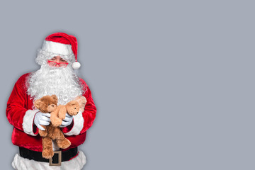 Santa claus have a teddy for children,merry christmas,Gifts for Children,Portrait of santa claus on white background,December is the month of Christmas.