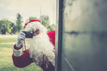 Santa claus with camera,Thailand people,Sent happiness for children,Merry christmas,Welcome to winter