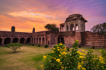 Mandu India, afghan ruins of islam kingdom, mosque monument and muslim tomb. Colorful sky at sunrise.