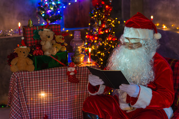 Santa Claus holding Paper and read it,Merry christmas,Happiness to the children,Welcome to winter,Happy new year