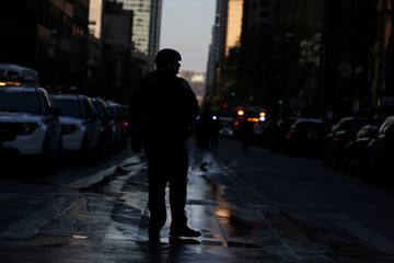 New York Police Department (NYPD) officer stands guard near Port Authority Bus Terminal after reports of an explosion in New York