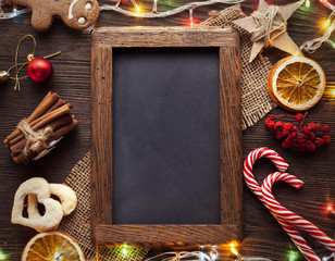 chalkboard gingerbread Christmas tree and gifts on table (top view)