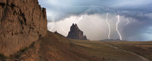 Foto auf Leinwand Dunkelbraun A Violent Thunderstorm at Shiprock, New Mexico