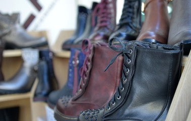 winter boots display for sale in clothing store