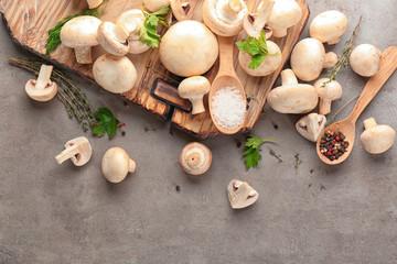 Fresh champignon mushrooms on table