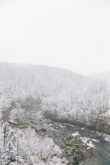 River Through Snowy Mountains