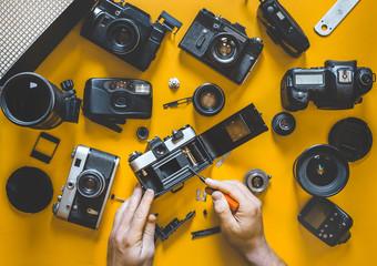 Human Hands Repair Broken Film Camera, Top View
