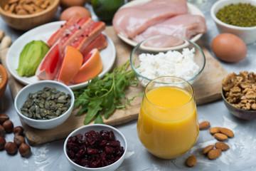 Orange juice against protein source food background