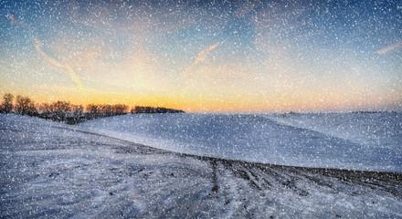winter field. snowfall on a hilly field