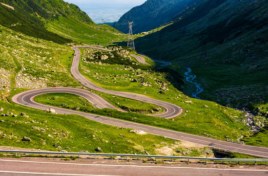 Transfagarasan road in Romanian mountains. winding serpentine among the grassy hills on a sunny morning