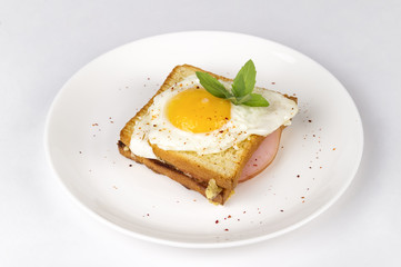 Croque Madame - sandwich with ham, cheese and fried egg.Traditional French breakfast,