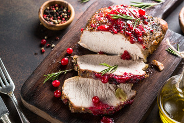 Pork ham baked with cranberry sauce.