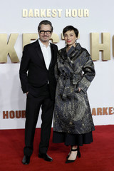 Actors Gary Oldman and Kristin Scott Thomas poses for photographs as they arrive at the UK premiere of Darkest Hour in London