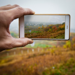Photographing autumn landscape
