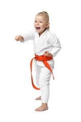 Little girl practicing karate on white background
