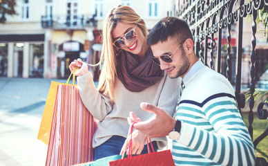 Shopping time. Beautiful couple in shopping. Consumerism, shopping, lifestyle concept