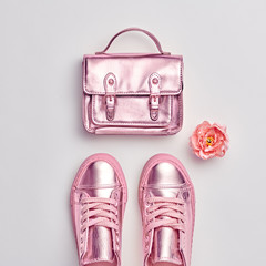 Fashion. Woman Gold Accessories Set. Flat lay. Trendy fashion Handbag, Glamour Rose gold Shoes, Flower. Minimal Style. Luxury Spring Hipster Girl. Pastel Color