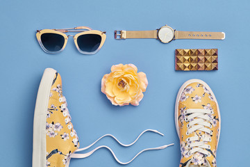 Fashion. Woman Accessories Set. Flat lay. Trendy Watch, Summer Sunglasses, Glamour fashion Yellow Floral Sneakers. Flower. Stylish Spring Hipster Girl. Pastel Color Wall mural