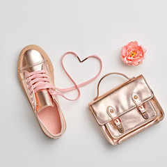 Fashion. Woman Gold Accessories Set. Flat lay. Trendy fashion Handbag, Glamour Shoes, Heart, Flower. Minimal Style. Luxury Spring Hipster Girl. Love, Valentines day