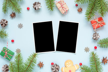 christmas blank photo cards in frame made of fir tree branches, decorations and gift boxes