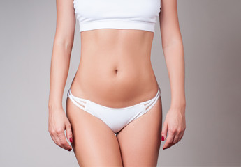 Woman waist. Girl with perfect body shape, flat belly in underwear.