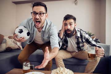 Soccer fans watching game in the room