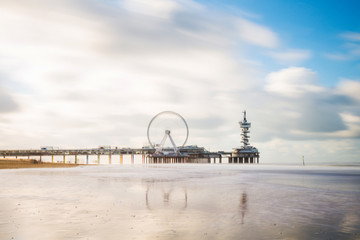 Beautiful day at Scheveningen beach, Netherlands with famous Pier in the background, November 2017