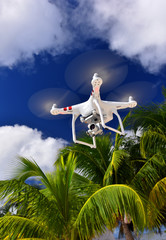 Drone copter flying with digital camera in tropics. Innovation photography concept.
