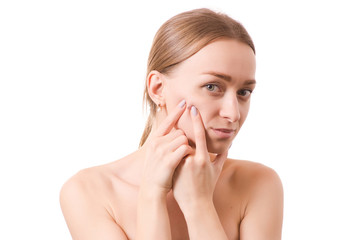 Beautiful young woman beauty face pressing pimple