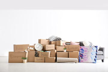 Carton boxes with stuff in room. Moving house concept