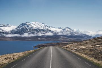 Looking down a road towards Dalvik along Eyjafjordur in North Iceland