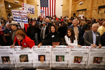 Supporters hold signs before a campaign rally for Republican candidate for U.S. Senate Judge Roy Moore in Midland City