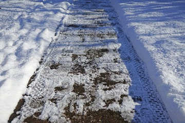 Cleaning up a sidewalk after a snow fall