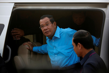 Cambodia's Prime Minister Hun Sen arrives for a meeting with garment workers on the outskirts of Phnom Penh