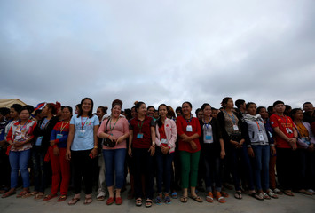 Garment workers attend a meeting with Cambodia's Prime Minister Hun Sen on the outskirts of Phnom Penh