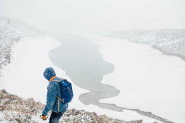 Hiker hiking on snow mountain in winter