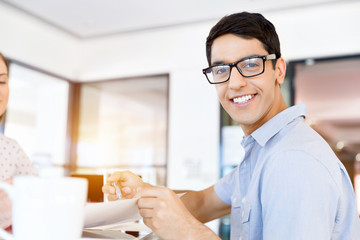 Young man in casual in office