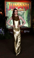 "Cast member Gillan poses at the premiere for ""Jumanji: Welcome to the Jungle"" in Los Angeles"