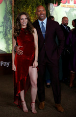 "Cast member Johnson and Lauren Hashian pose at the premiere for ""Jumanji: Welcome to the Jungle"" in Los Angeles"