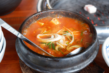 Korea spicy kimchi tofu soup bowl in restaurant