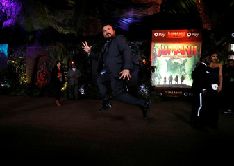 "Cast member Black poses at the premiere for ""Jumanji: Welcome to the Jungle"" in Los Angeles"