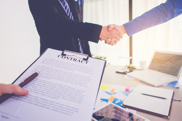 businesspeople hand shake while business meeting and sign the contract in office.
