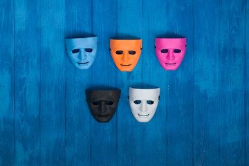 colored masks on a blue background