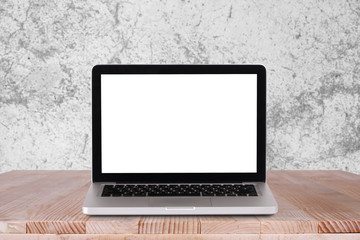 Front view of the laptop is on the work table with white concrete background