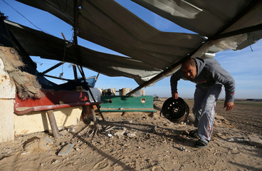 A Palestinian man inspects a militant target that was hit in an Israeli airstrike in the southern Gaza Strip