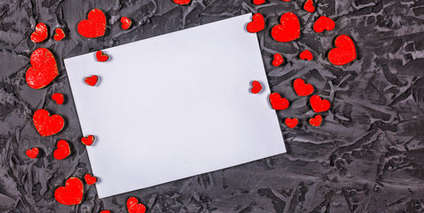 Valentine's Day, Valentine's Day. Hearts and empty frame on a stone black background