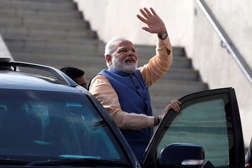 India's Prime Minister Narendra Modi waves to his supporters before boarding a sea-plane on the Sabarmati river on the last day of campaigning ahead of the second phase of Gujarat state assembly elections, in Ahmedabad